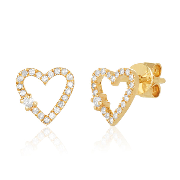 Diamond pavé stud earrings in a heart shape with open center and single larger diamond offset on the edge.