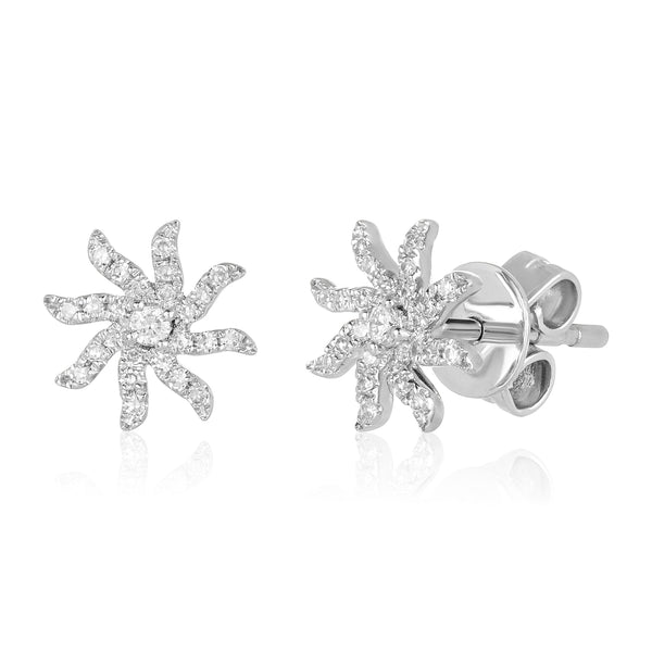 Diamond stud earrings in 14 karat white gold in a sun motif with center solitaire diamond and diamond pavé rays.