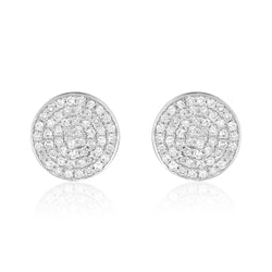 Round stud earrings in 14 karat with gold with diamond pavé surface.