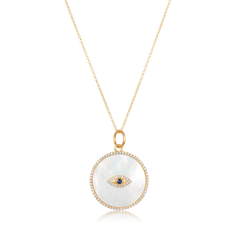 14 karat gold necklace with large circular pendant in mother of pearl with diamond pavé trim; sapphire and diamond evil eye motif at center.