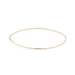 delicate 24 karat gold vermeil bangle with smooth texture