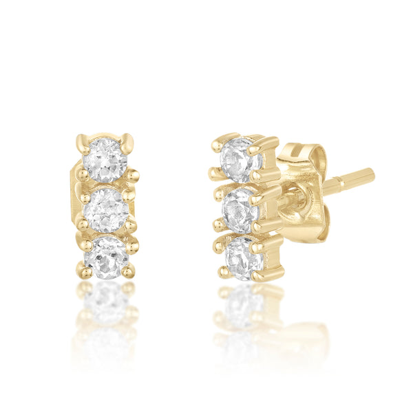 Dainty mini studs with a trio of white topaz stones