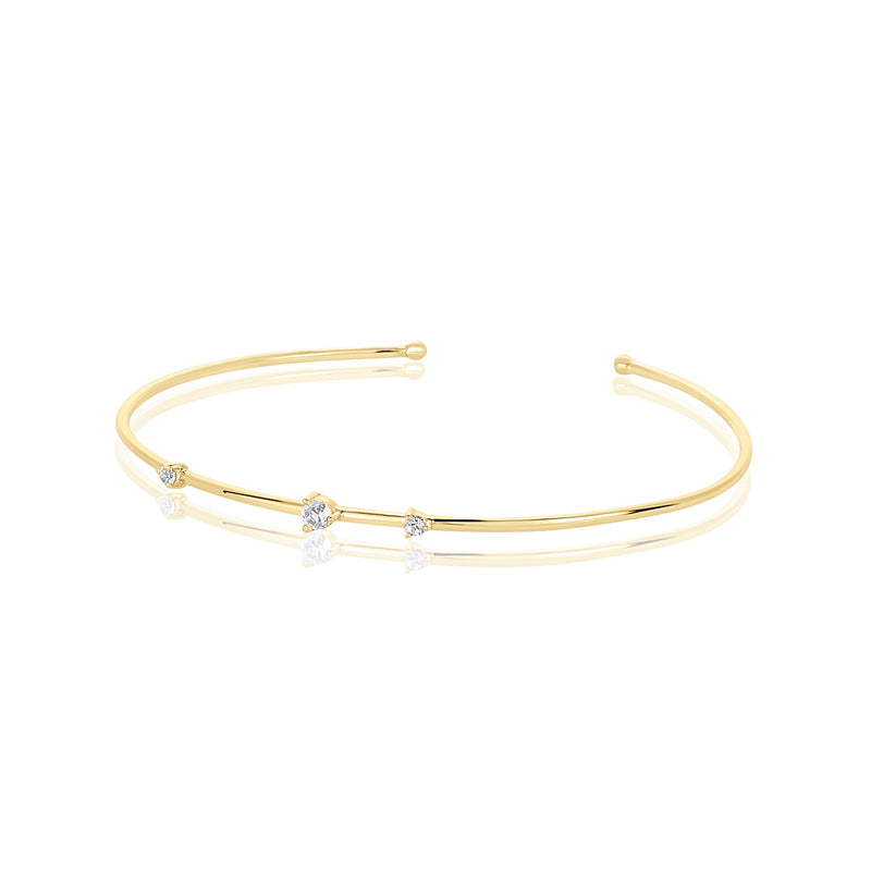 Delicate cuff bracelet with three small white topaz stones