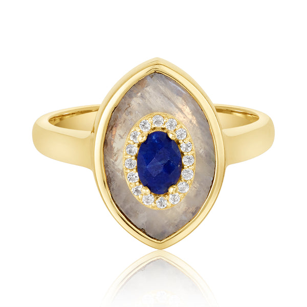 "Ring with a double-pointed oval ""eye"" motif; center deep blue lapis stone with white topaz trim and moonstone flange."