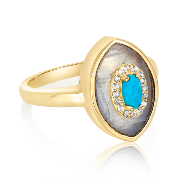 "Ring with a double-pointed oval ""eye"" motif; center turquoise stone with white topaz trim and moonstone flange."
