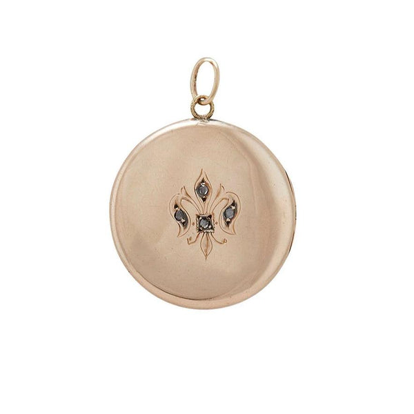 vintage locket with fleur de lys motif