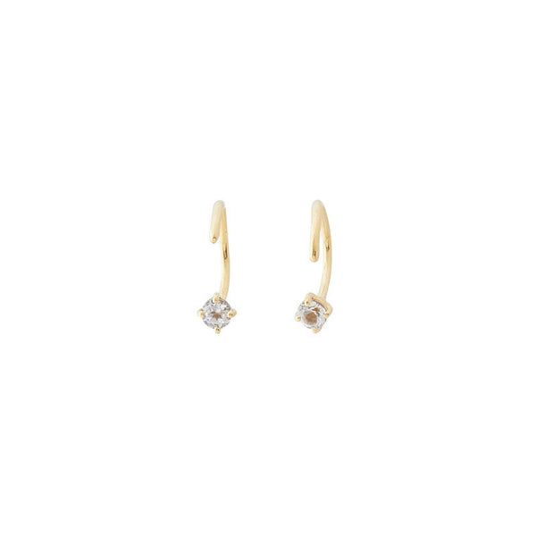 dainty huggies with a white topaz stone