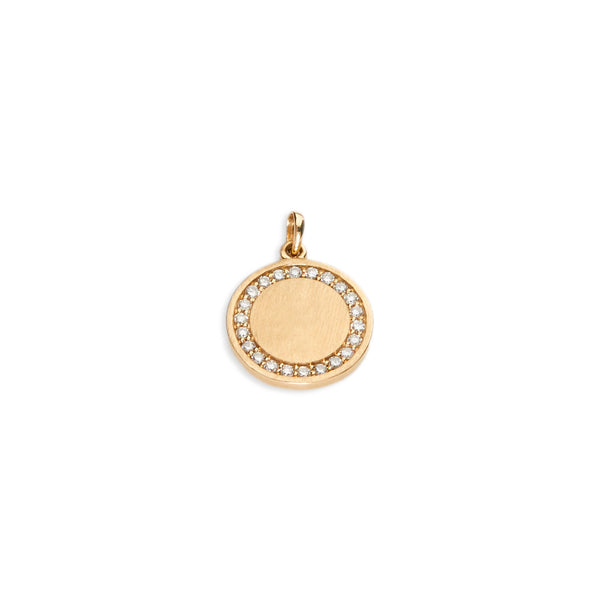 disc charm in 14 karat yellow gold with edge of diamonds