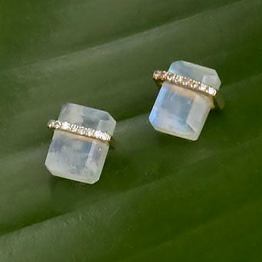 moonstone stud earrings with a band of pavé diamonds