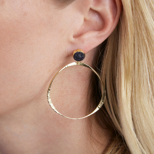 front facing hammered hoop earring with moonstone stud