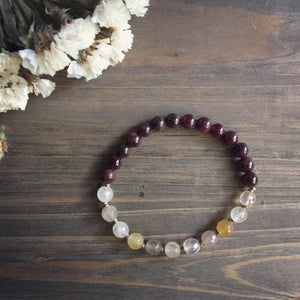 rutilated quartz + garnet