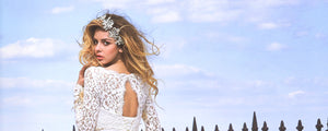 an-edmonton-bride-in-a-svitlana-dress-standing-in-front-of-a-blue-sky