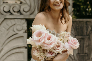 an-edmonton-bride-in-a-svitlana-custom-dress-holding-a-pink-bouquet