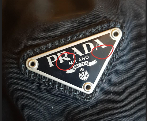 Black Prada Triangle plate with red circles to identify parts