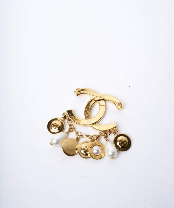 Chanel Chanel CC gold pearl buttoned drop brooch