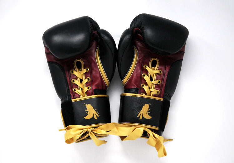Elegant style to a pair of black red and gold boxing gloves with Flight boxing logo.