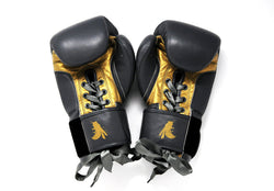 Elegant style to a pair of silver and gold boxing gloves with Flight boxing logo.