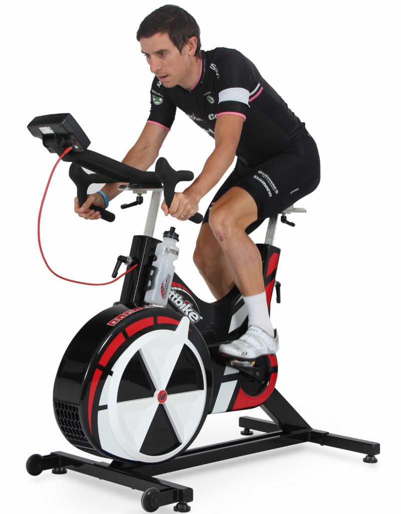 Watt bike being used by an athletic male.