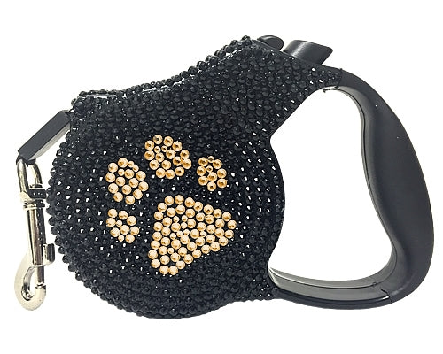 Crystal retractable lead in black and gold paw print design
