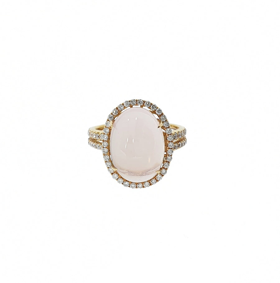18ct Rose Gold Oval Cabochon Rose Quartz & Diamond Halo Ring. Rose Quartz Weight 7.13ct, Diamond Weight 0.47ct.