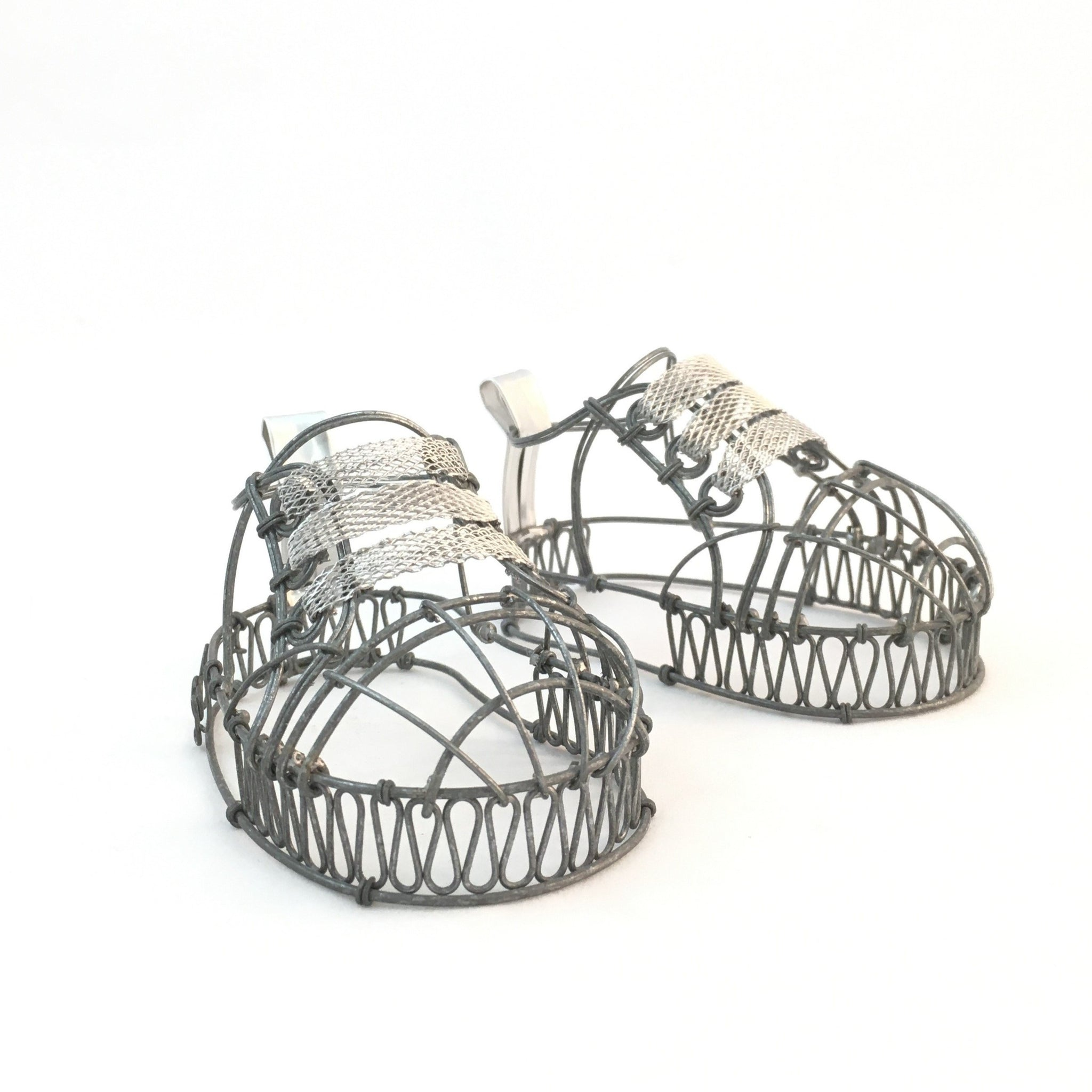 Wire baby shoes by Natalie Fong