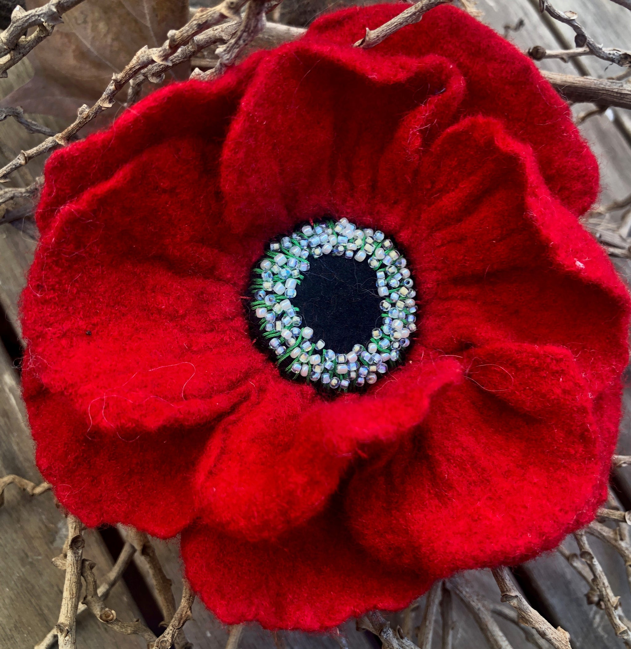 Felted poppy flower by Grace Levis