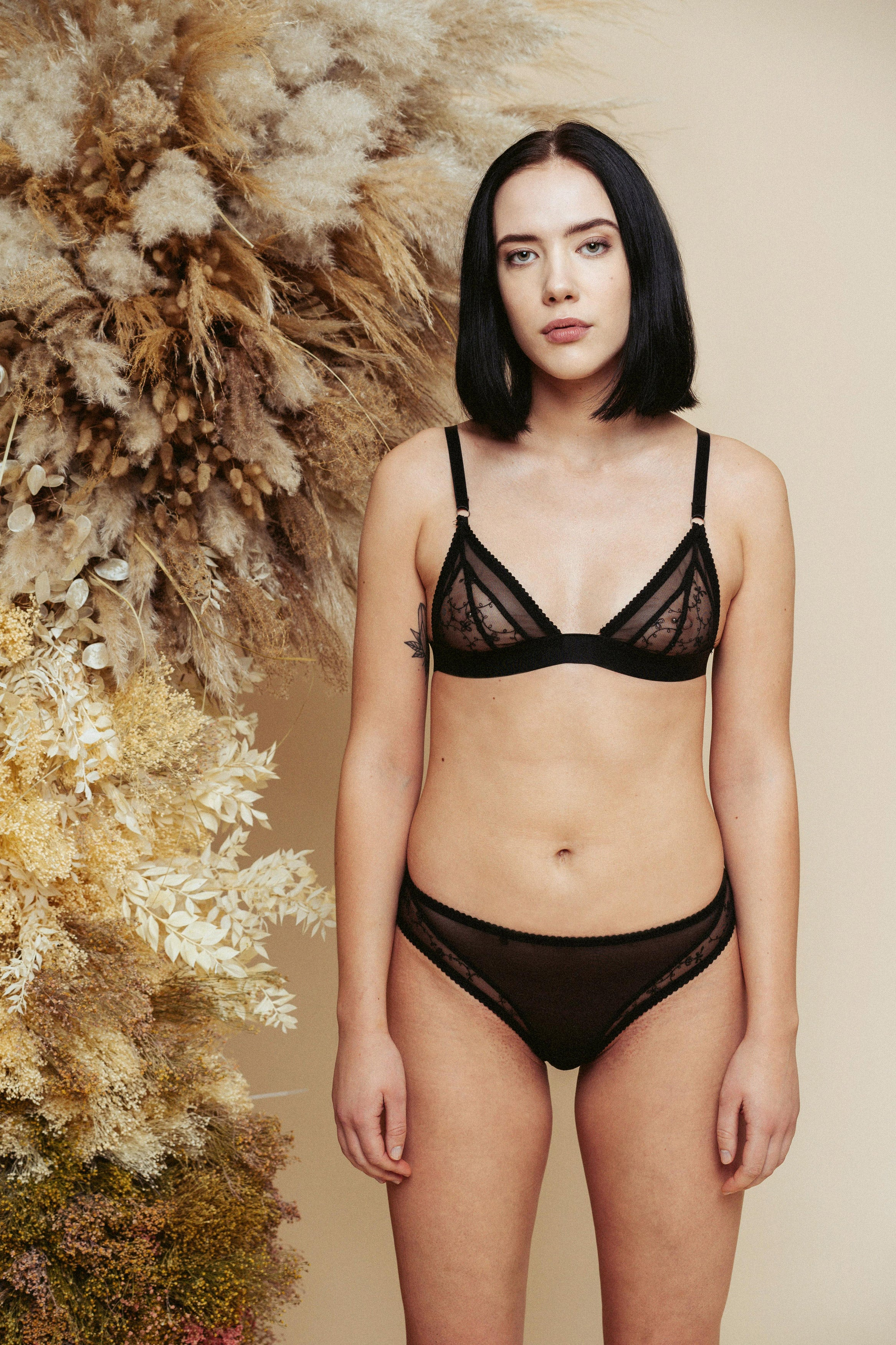 Model wearing the Kauf Triangle Bralette and Brazilian Knicker in black