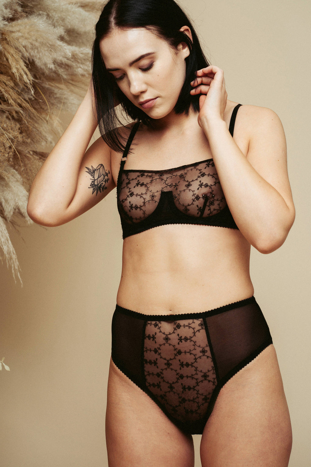 Model wearing the Kauf High Waisted Knicker and Bandeaux Wire Bra in black