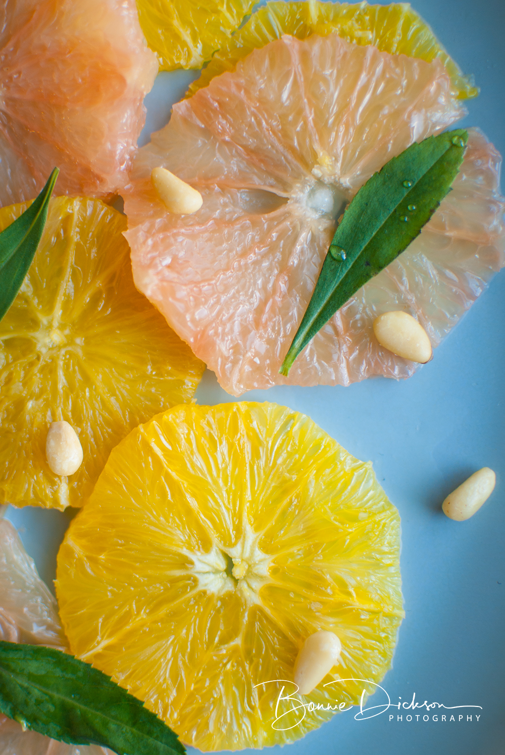 Citrus Top Down, fresh slices and pine nuts