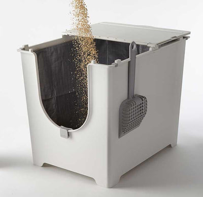Once the Flip Tarp Liner is secured fill the Flip Litter Box with clumping cat litter.