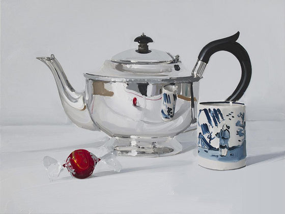 Silver Teapot with Chocolate and cup