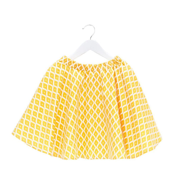 Girls twirling diamond shape skirt