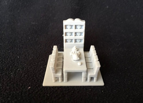 HO Scale Miniature Dining Room Insert including dining table w/ food, chairs, and hutch.