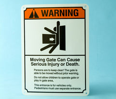"""CAUTION! AUTOMATIC GATE"" signs"