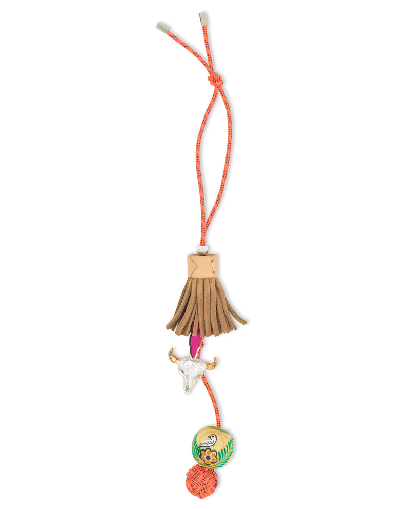Bolo tie charm with leather tassel, by Consuela