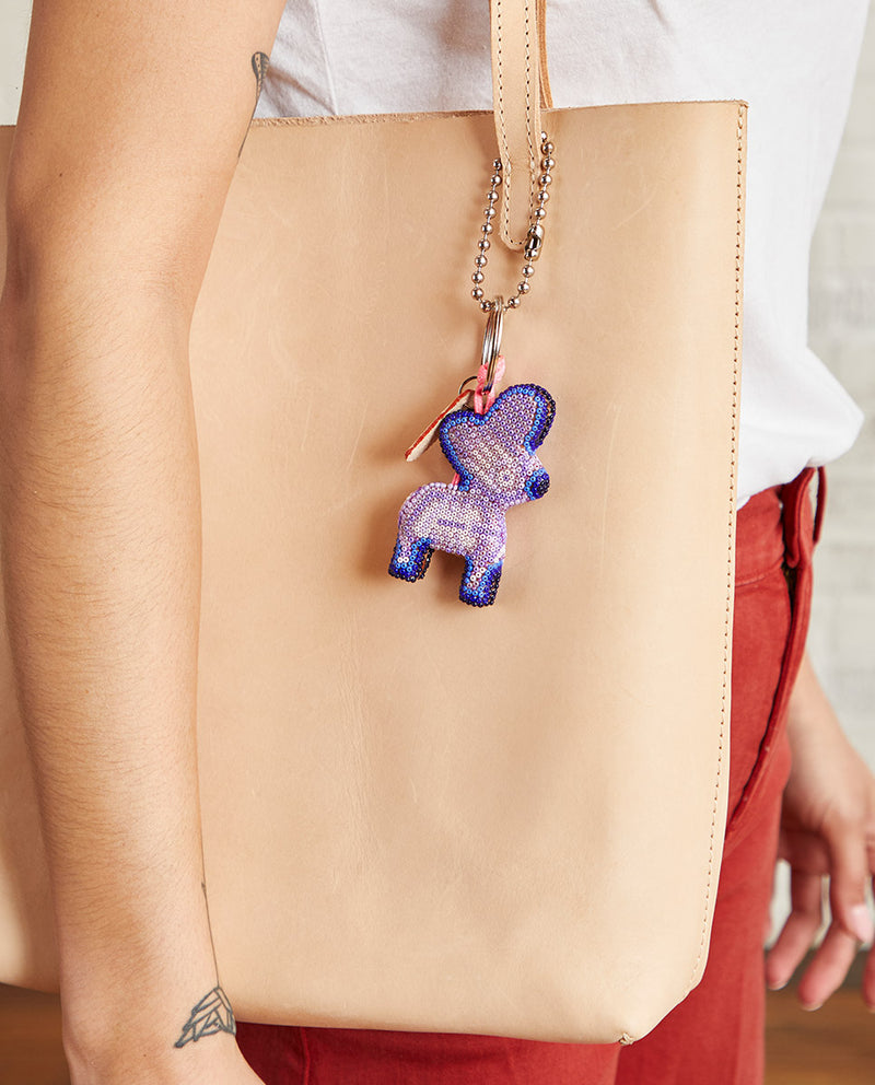 Donkito Lila Charm with beaded donkey by Consuela, lifestyle view