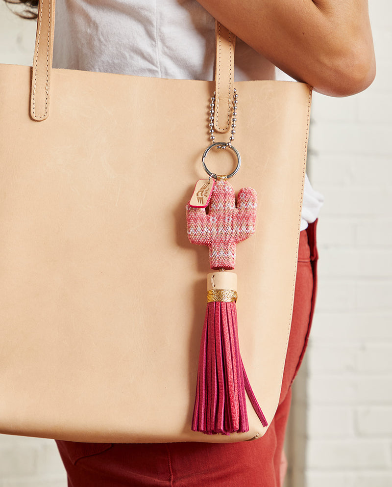 Pink Prickly Charm with pink beaded cactus and pink tassel by Consuela, lifestyle view