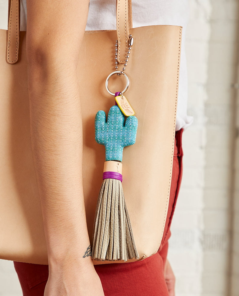 Paloma Prickly Charm with blue beaded cactus by Consuela, lifestyle view