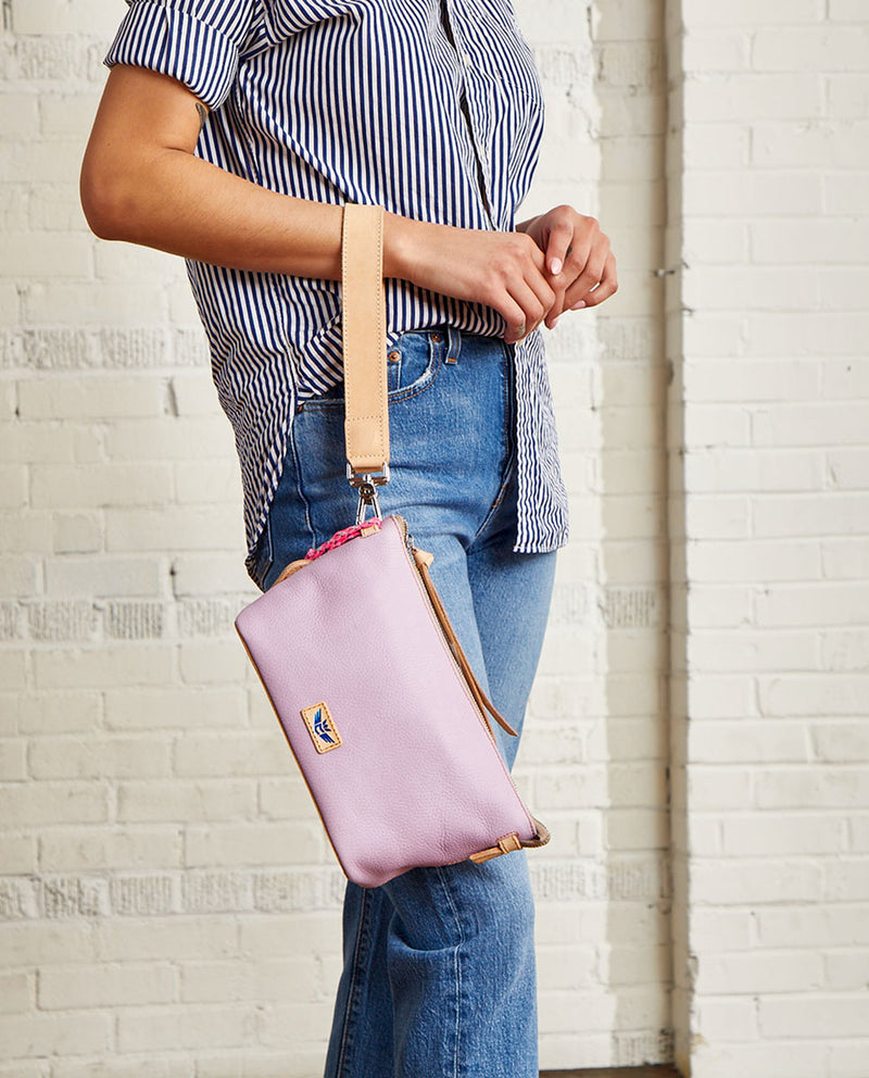 Lila Your Way Bag in lilac pebbled leather, on model as a wristlet