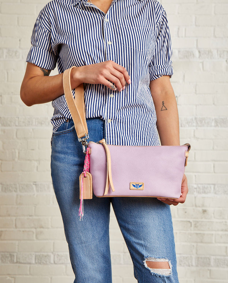 Lila Your Way Bag in lilac pebbled leather, on model as wristlet