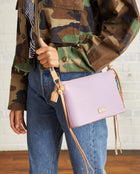 Lila Midtown Crossbody in lilac pebbled leather by Consulea, model view