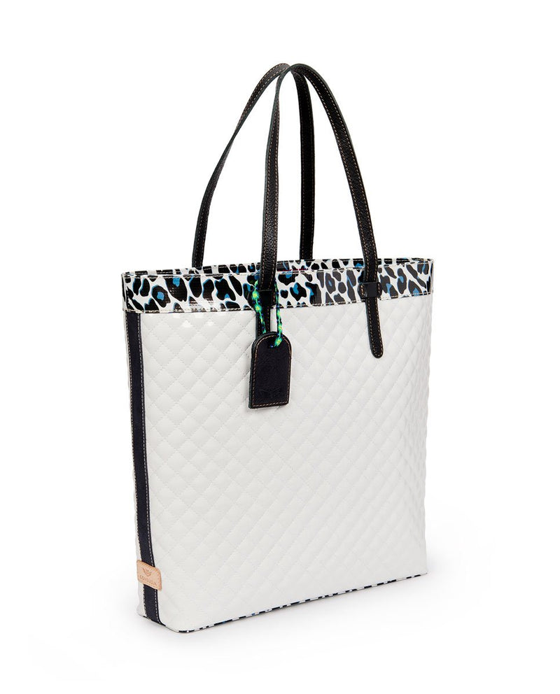Tate Slim Tote with quilted white exterior and Lola ConsuelaCloth accent by Consuela, side view