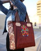Martina Classic Tote in waxed canvas with floral embroidery by Conseula, model image