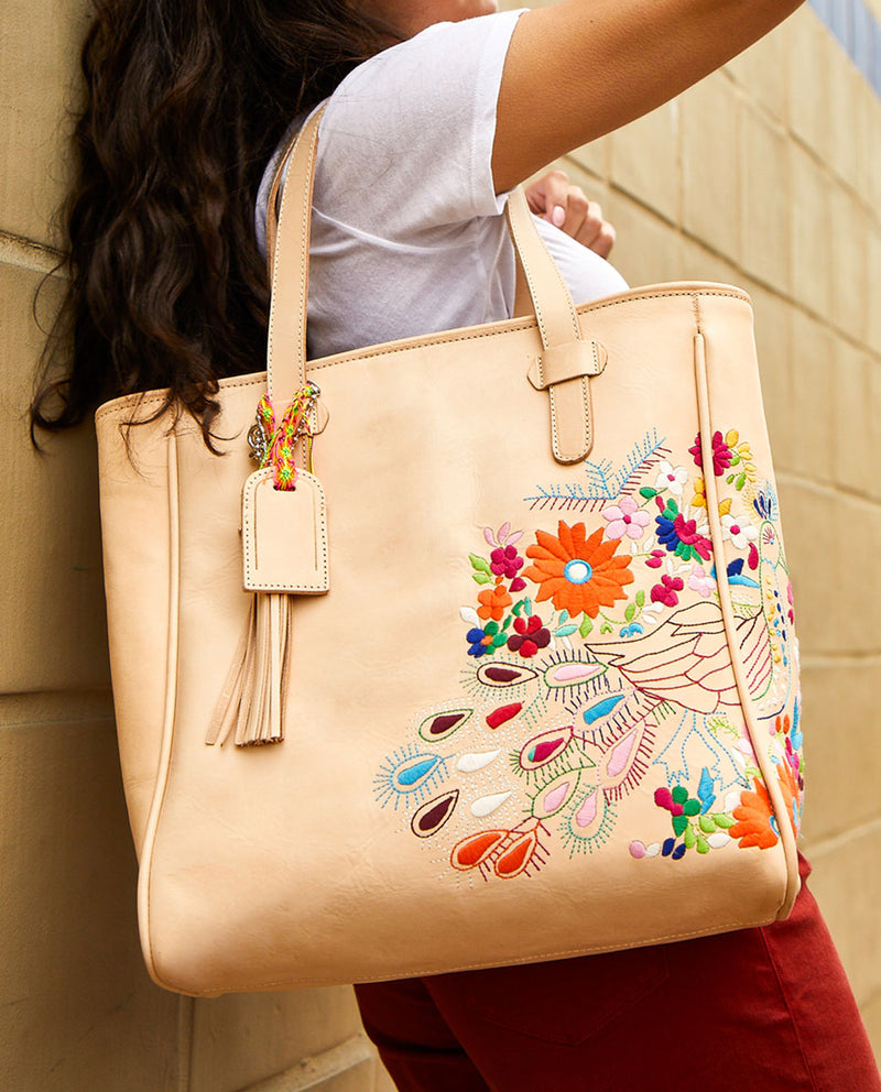 Sunny Classic Tote in natural leather with peacock embroidery by Consuela, model view