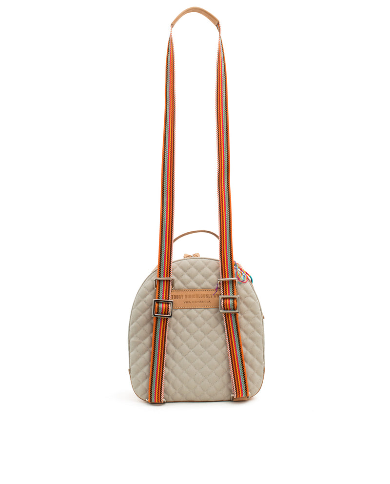 Echo City Pack in cream quilted waxed canvas with floral embroidery, by Consuela, back view with crossbody strap