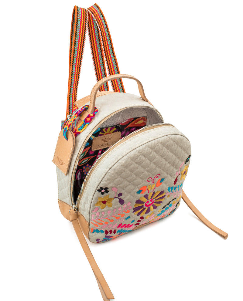 Echo City Pack in cream quilted waxed canvas with floral embroidery, by Consuela, back view as a backpack