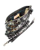 Charli Fiesta Crossbody in black metallic leather by Consuela, side view