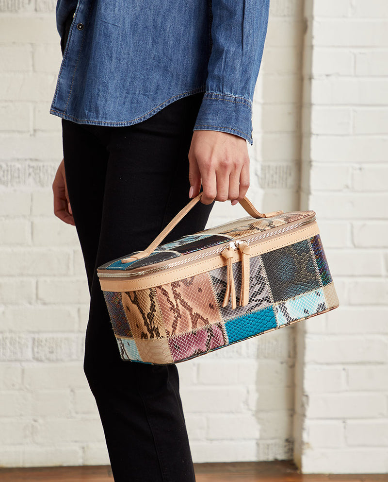 Sadie Train Case in patchwork snake print by Consuela, model view