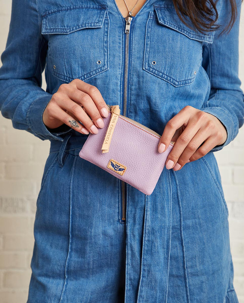 Lila Pouch in lilac pebbled leather by Consuela, model view