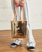 Goldie Everyday Tote in gold metallic by Consuela, lifestyle view